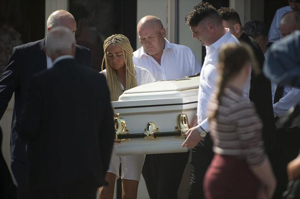 Relatives carry the remains of her two year old daughter Santina at her removal in Cork. Pic Michael Mac Sweeney/Provision