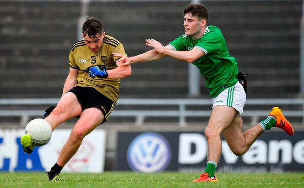 Cathal Ferriter of Kerry in action against Niall McAuliffe of Limerick. Photo: Brendan Moran/Sportsfile