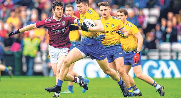 Case for defence: Conor Daly brushes aside Galway's Ian Burke to sweep up the danger during the Connacht final. Photo: Sportsfile