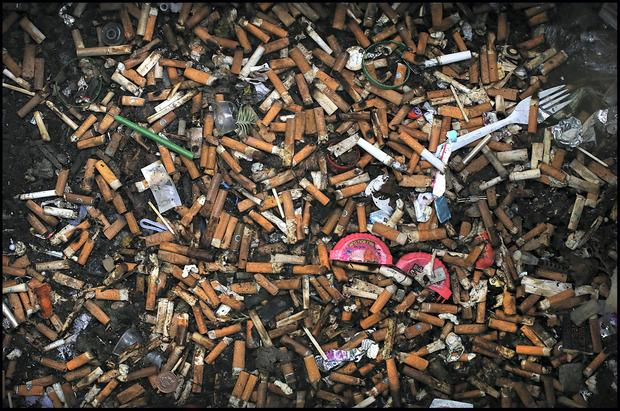 Dirty: Littering could be halved if cigarettes were disposed of correctly, says Minister Richard Bruton. Photo: Steve Humphreys