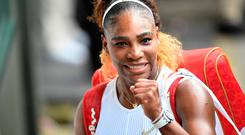 All smiles for Serena: Serena Williams gestures to the crowd after booking her place in the Wimbledon final. The 37-year-old will bid to match Margaret Court's record of 24 Grand Slams tomorrow when she faces Simona Halep in the final. Photo: AFP/Getty Images