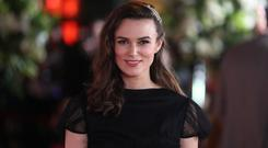 British actor Kiera Knightley poses for photographers upon arrival to attend the world premiere of the film
