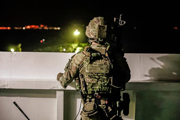 A British soldier looks on during an operation involving the oil supertanker Grace 1, that's on suspicion of carrying Iranian crude oil to Syria, in waters off the British overseas territory of Gibraltar, historically claimed by Spain, July 4, 2019. UK Ministry of Defence/Handout via REUTERS