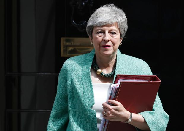 Britain's Prime Minister Theresa May leaves 10 Downing Street for her weekly Prime Minister's Questions at the House of Commons in London (AP Photo/Alastair Grant)
