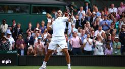 Roger Federer of Switzerland celebrates match point against Rafael Nadal at Wimbledon (Photo by Mike Hewitt/Getty Images)