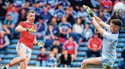 Brian Hurley of Cork scores his second goal past Laois goalkeeper Graham Brody during their qualifier clash at Semple Stadium; the forward says Cork will be 'going for' Dublin. Photo: Matt Browne/Sportsfile