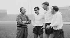 England manager Alf Ramsey chats with Barry Bridges, Jack Charlton and Nobby Stiles in April 1965 during training for their match against Scotland at Wembley