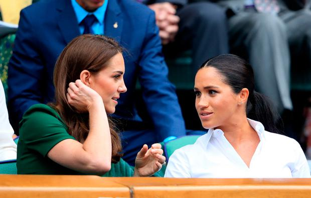 The Duchess of Cambridge and The Duchess of Sussex on day twelve of the Wimbledon Championships at the All England Lawn Tennis and Croquet Club, Wimbledon
