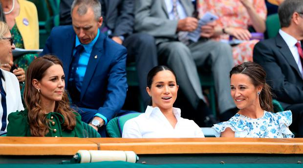 The Duchess of Cambridge and The Duchess of Sussex with Pippa Matthews on day twelve of the Wimbledon Championships at the All England Lawn Tennis and Croquet Club, Wimbledon