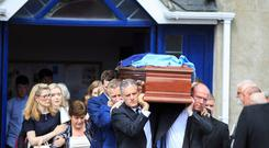 The coffin of John Bailey is shouldered from the Church of the Assumption, Dalkey. Pic:Mark Condren
