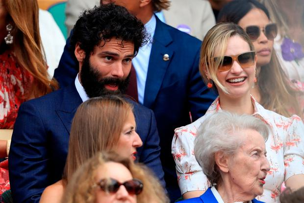 Aidan Turner and Lily James on day twelve of the Wimbledon Championships at the All England Lawn Tennis and Croquet Club, Wimbledon. PRESS ASSOCIATION Photo. Saturday July 13, 2019. Adam Davy/PA Wire.