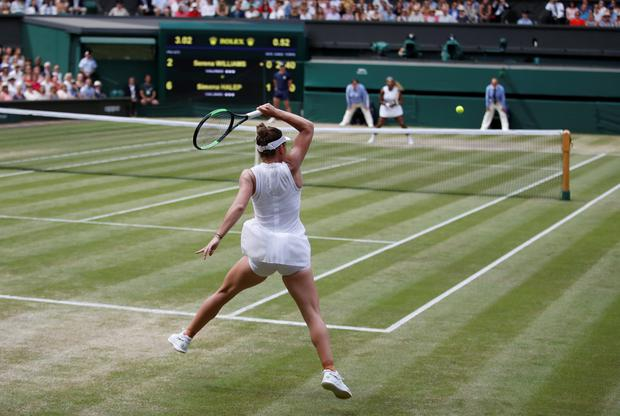 Romania's Simona Halep returns a shot during today's Wimbledon ladies final against Serena Williams of the US. Photo: REUTERS/Carl Recine