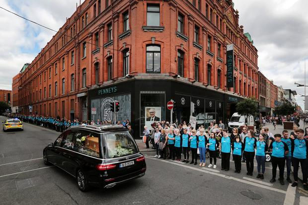The funeral cortege for Penneys/Primark founder Arthur Ryan makes its way past the location of the first ever Penneys store, on Mary Street, Dublin. Picture By David Conachy. 13/7/2019