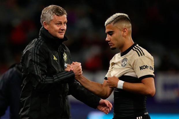 Ole Gunnar Solskjaer, manager of Manchester United acknowledges Andreas Pereira of Manchester United at half time during the match between the Perth Glory and Manchester United at Optus Stadium. Photo: Paul Kane/Getty Images