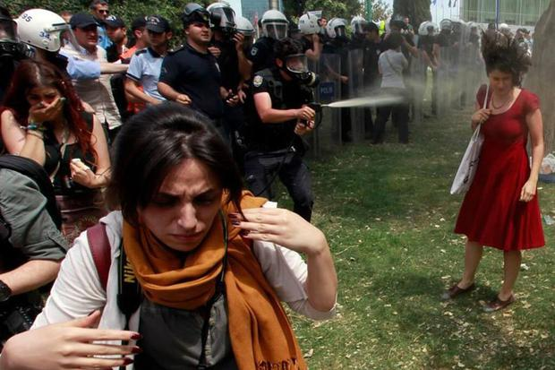 Turkish police attack Gezi Park protesters with pepper spray in June 2013.