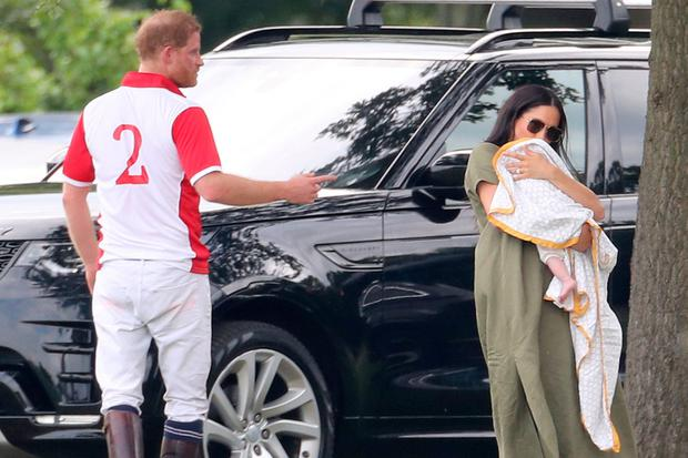 Meghan, who was trolled for holding baby Archie incorrectly, while watching Prince Harry play polo. Photo: Getty