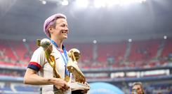Megan Rapinoe celebrates with the FIFA Women's World Cup Trophy, the Golden Boot and the Golden Ball. Photo: Alex Grimm/Getty Images