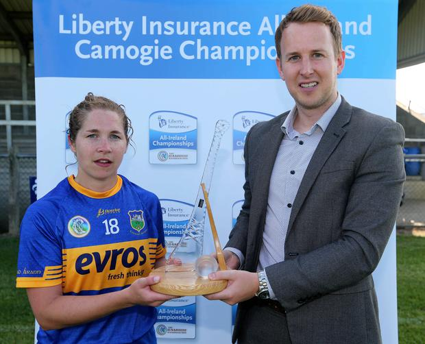 Tipperary's Mary Ryan receives the player of the match award from Dave Coffey of Liberty Insurance after her side's victory over Dublin in the All-Ireland senior camogie championship round 4 clash at The Ragg. Photo: Lorraine O'Sullivan