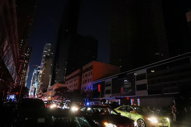 Residential buildings light out near Times Square area, as a blackout affects buildings and traffic during widespread power outages in the Manhattan borough REUTERS/Jeenah Moon