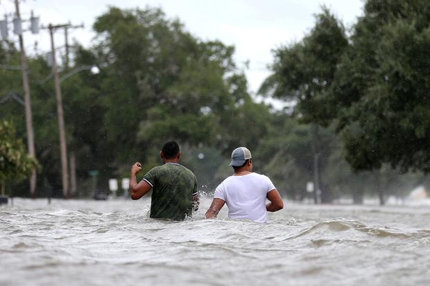 People wade through a flooded street after Hurricane Barry in Mandeville, Louisiana REUTERS/Jonathan Bachman