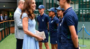 The Duke and Duchess of Cambridge meet ballboys and ballgirls (left to right) Tom Hubner, 15, Rhianne Black, 14, Kayleigh Man, 13 and Cassius Hayman, 15, ahead of the Men's Singles Final on day thirteen of the Wimbledon Championships at the All England Lawn Tennis and Croquet Club, Wimbledon. Sunday July 14, 2019. See PA story SPORT Wimbledon. Photo credit should read: Victoria Jones/PA Wire