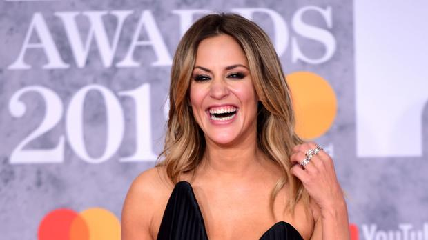 Caroline Flack will deliver bad news (Ian West/PA)