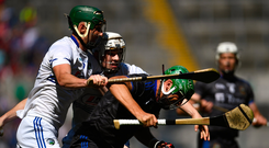 James Barry of Tipperary in action against Eanna Lyons, left, and Aaron Dunphy of Laois during the GAA Hurling All-Ireland Senior Championship quarter-final match at Croke Park in Dublin. Photo by Ramsey Cardy/Sportsfile