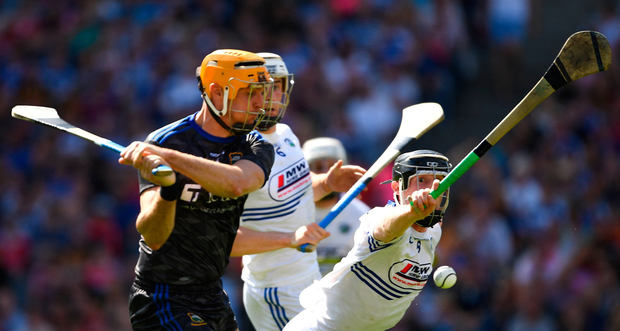Séamus Callanan of Tipperary shoots past John Lennon of Laois to score his side's second goal, in the 16th minute, during the GAA Hurling All-Ireland Senior Championship quarter-final match between Tipperary and Laois at Croke Park in Dublin. Photo by Ray McManus/Sportsfile