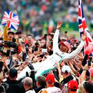 Race winner Lewis Hamilton of Great Britain and Mercedes GP celebrates with fans after the F1 Grand Prix of Great Britain at Silverstone on July 14, 2019 in Northampton, England. (Photo by Mark Thompson/Getty Images) BESTPIX