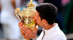Novak Djokovic of Serbia kisses the trophy after winning his Men's Singles final against Roger Federer of Switzerland during Day thirteen Wimbledon 2019 at All England Lawn Tennis and Croquet Club. (Photo by Matthias Hangst/Getty Images)