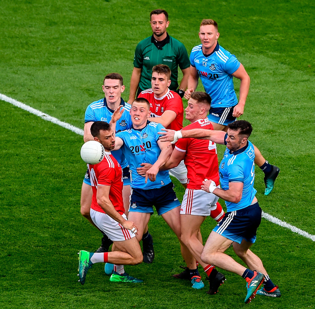 Dublin players, left to right, Brian Fenton, Con O'Callaghan, Ciarán Kilkenny, and Michael Darragh Macauley in action against Cork players, left to right, Kevin O'Driscoll, Ian Maguire, and Kevin Flahive: Photo: Daire Brennan/Sportsfile