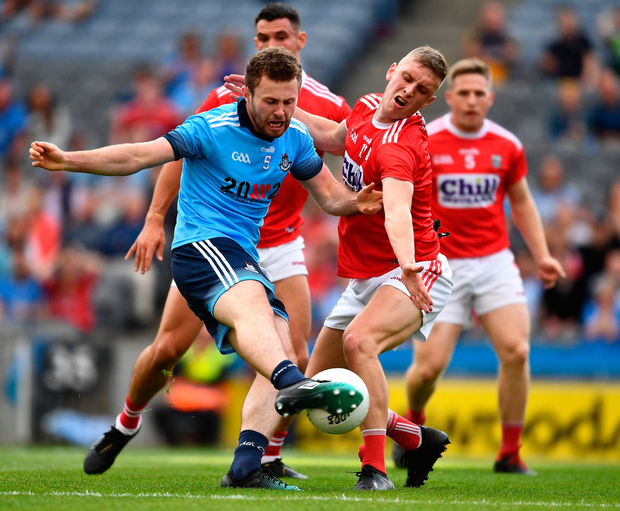 Jack McCaffrey works just enough space to shoot past Cork's Seán White to score Dublin's first goal at Croke Park on Saturday. Photo: Ray McManus/Sportsfile