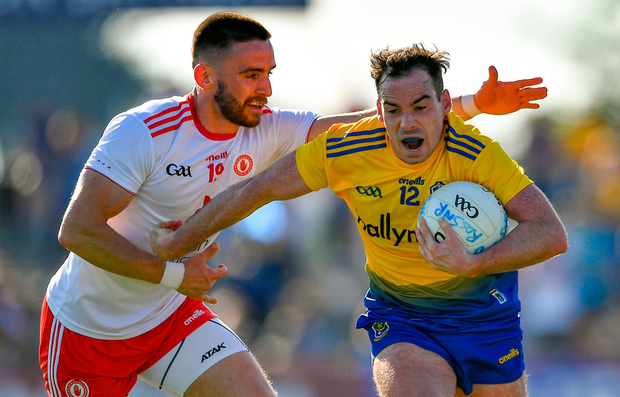 Niall Kilroy of Roscommon is tackled by Padraig Hampsey of Tyrone. Photo: Brendan Moran/Sportsfile