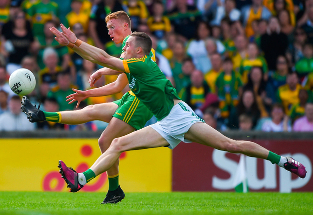 Best foot forward: Oisín Gallen of Donegal in action against Conor McGill of Meath during yesterday's clash at Ballybofey. Photo: Daire Brennan/Sportsfile