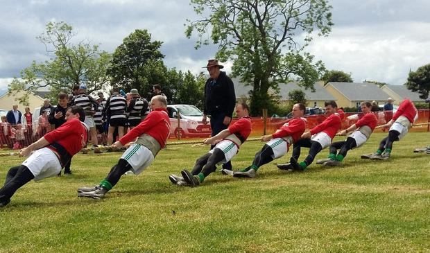 Emotional pull: Treasurer Anthony Pender (wearing hat) with members of the Irish Tug of War Association