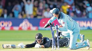 Jos Buttler breaks the stumps with New Zealand batsman Martin Guptill short of his ground as England won the World Cup at Lord's. Photo: Peter Cziborra/Action Images via Reuters