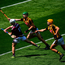 Galway's Sean McDonagh gets his shot away despite the efforts of Kilkenny's Peter McDonald (left) and William Halpin during the Electric Ireland. Photo: Ramsey Cardy/Sportsfile