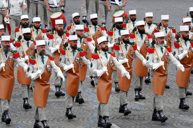 Sharp look: Pioneers of the Foreign Legion lead the regiment in Paris armed with their traditional axes. Photo: Reuters