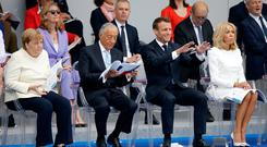 Parade: Germany's Angela Merkel, Portugal's Marcelo de Sousa, and France's Emmanuel Macron at a Bastille Day event in Paris. Photo: REUTERS/Pascal Rossignol