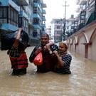 Seeking safety: Residents leave a flooded colony in Kathmandu. Photo: REUTERS/Navesh Chitrakar