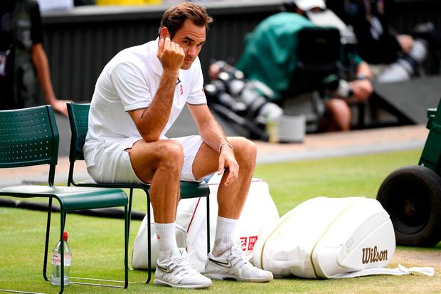 Federer slumps on his seat after the exhausting five-set final getty. Photo: Matthias Hangst/Getty Images