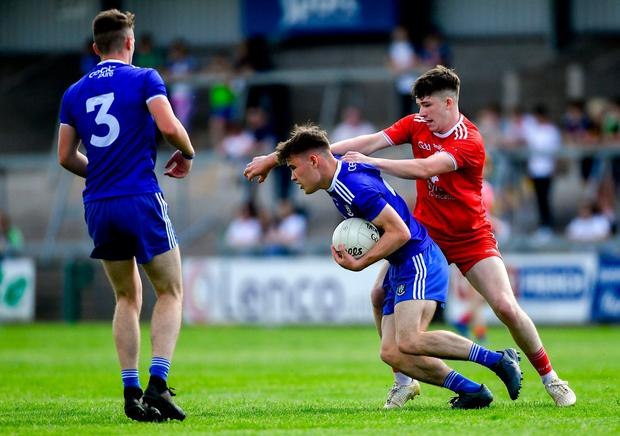 Shane Hanratty of Monaghan, supported by team-mate Ronan Boyle, left, is tackled by Daniel Fullerton of Tyrone. Photo: Piaras Ó Mídheach/Sportsfile