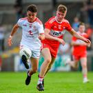 Darragh Canavan of Tyrone in action against Fintan Bradley of Derry. Photo: Piaras Ó Mídheach/Sportsfile