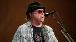 Neil Young performing earlier this summer. Photo: Isabel Infantes/PA Wire