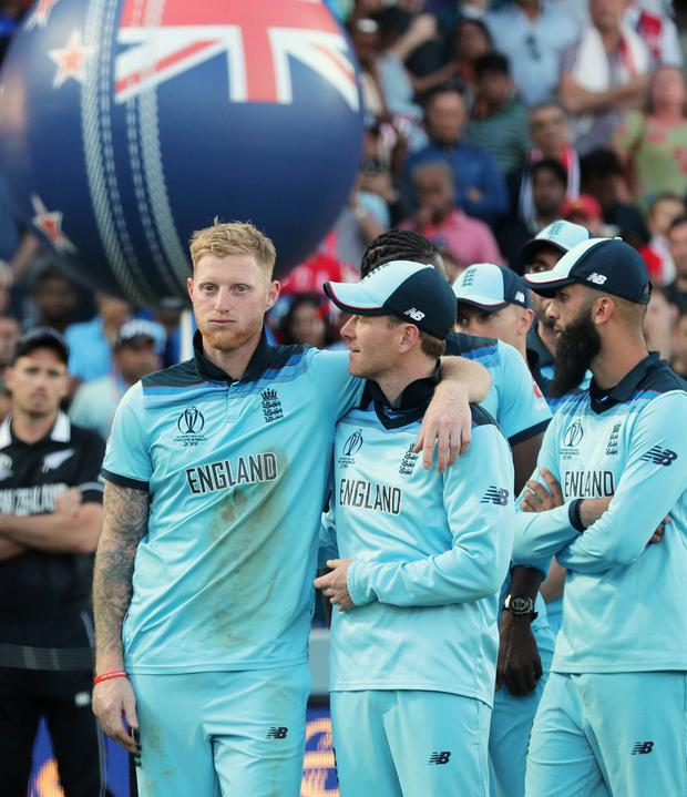 England's Ben Stokes, left, stands with his arms around England's captain Eoin Morgan as they wait for the presentation ceremony after winning the Cricket World Cup final match between England and New Zealand at Lord's cricket ground in London, England. Photo: AP Photo/Aijaz Rahi