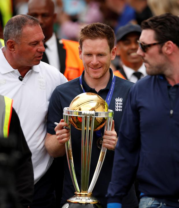 England captain Eoin Morgan with the Cricket World Cup trophy during the celebrations today at The Oval, London. Photo: Reuters/Andrew Boyers