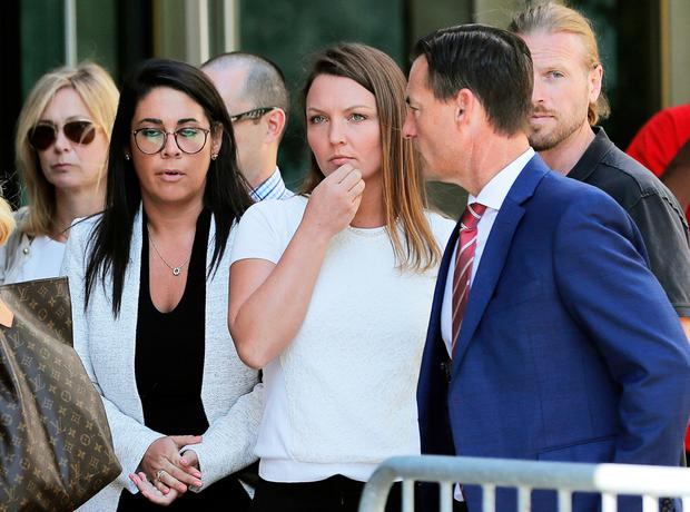 Accuser: Courtney Wild (centre), an alleged victim of Jeffrey Epstein, outside the New York courthouse. Photo: REUTERS/Lucas Jackson