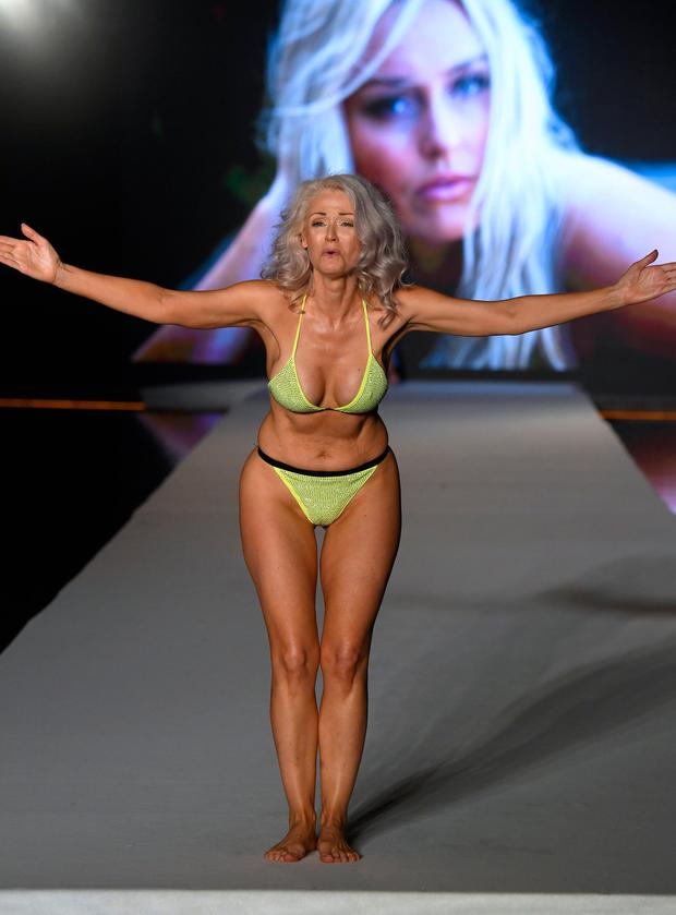 Kathy Jacobs walks the runway during the 2019 Sports Illustrated Swimsuit Runway Show During Miami Swim Week At W South Beach - Runway at WET poolside lounge at W South Beach on July 14, 2019 in Miami Beach, Florida. (Photo by Frazer Harrison/Getty Images for Sports Illustrated)