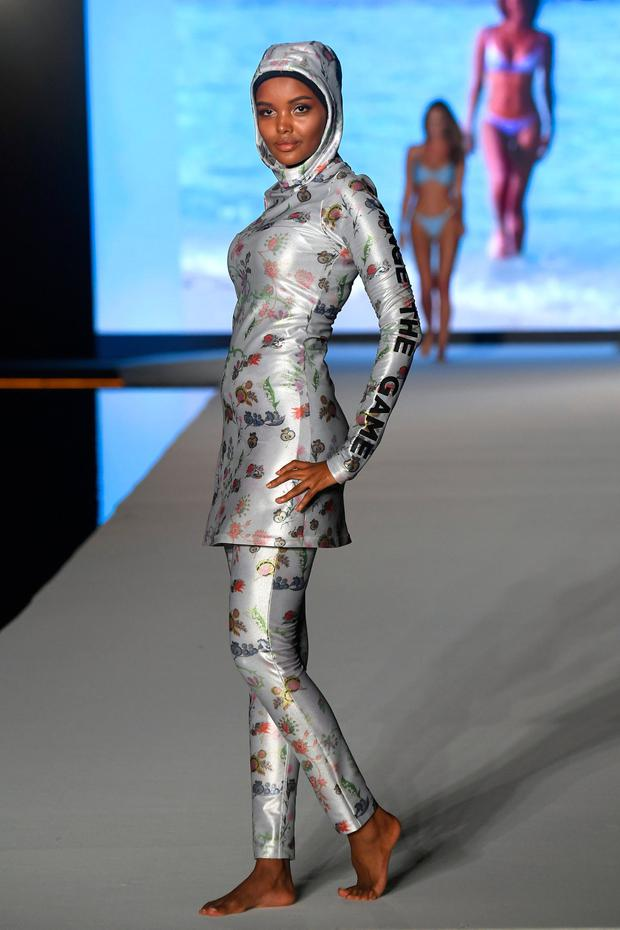Halima Aden walks the runway during the 2019 Sports Illustrated Swimsuit Runway Show During Miami Swim Week At W South Beach - Runway at WET poolside lounge at W South Beach on July 14, 2019 in Miami Beach, Florida. (Photo by Frazer Harrison/Getty Images for Sports Illustrated)