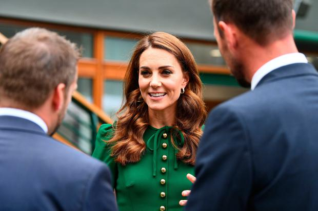 The Duchess of Cambridge meets staff and junior players ahead of the Women's Final on day twelve of the Wimbledon Championships at the All England Lawn Tennis and Croquet Club, Wimbledon